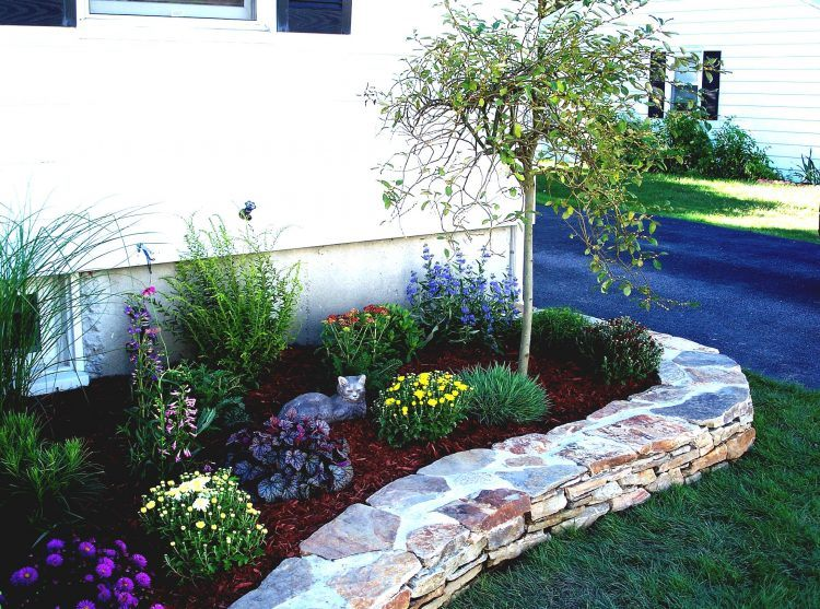 simple flower bed on side of home