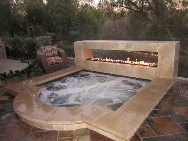 beautiful square hot tub with fire