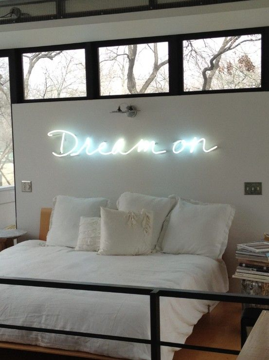dream on neon sign over bed