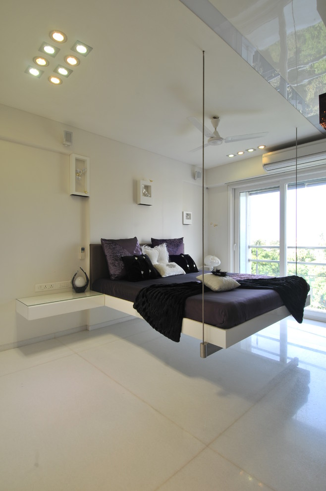 white bedroom with hanging bed