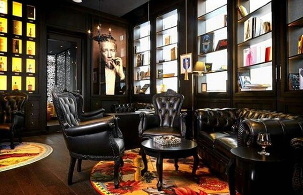 man cave with classic black leather furniture