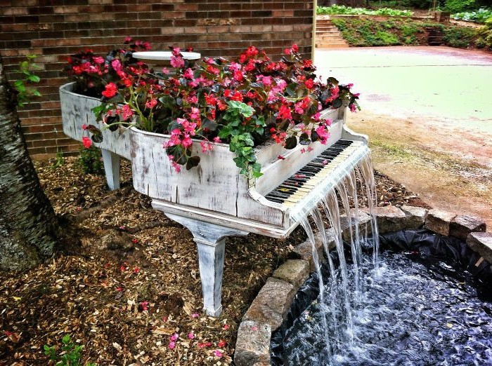 flower bed made in old piano